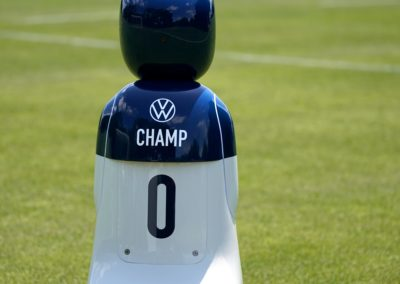 Volkswagen's CHAMP robot driving on a well manicured soccer field.